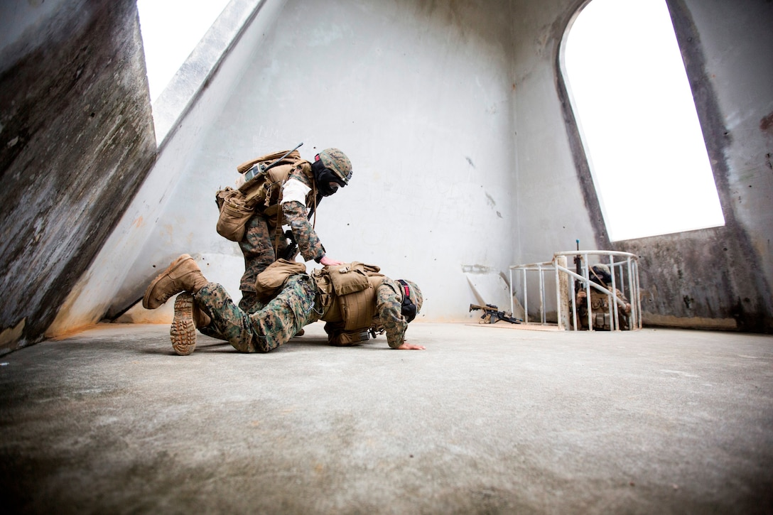 Marine with Weapons Company, Battalion Landing Team 2nd Battalion, 5th Marine Regiment, 31st Marine Expeditionary Unit, captures member of opposing force during urban combat training in Okinawa, Japan, February 8, 2014 (U.S. Marine Corps/Andrew Kuppers)