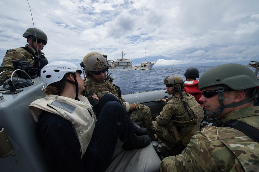 Sailors and Coast Guard Pacific Law Enforcement Detachment Team personnel approach Chinese fishing vessel during Oceania Maritime Security Initiative mission with USS Sampson, Pacific Ocean, November 29, 2016 (U.S. Navy/Bryan Jackson)