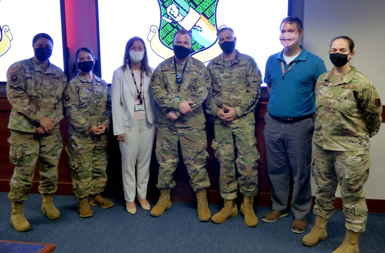 Organizers of Air Force Special Operations Command's Mission Defense Conference pose for a photo at Hurlburt Field, Fla., Feb. 5, 2021. The conference focused on identifying the organic cyber capabilities needed to protect missions against threats in, through, and from cyberspace. (Courtesy Photo)