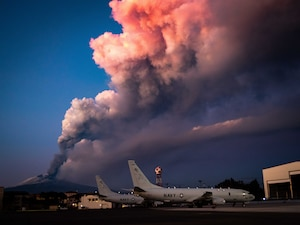 Mount Etna erupts near aircraft from Patrol Squadron (VP) 46 at Naval Air Station Sigonella.