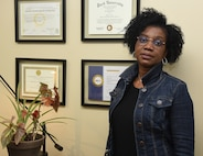 Ines Eley, a human resources specialist at Camp Johnson, Vermont, is a native of Brazzaville, Republic of Congo, who recently joined the Vermont National Guard in a civilian capacity. She speaks English, French, German, three Congolese dialects, and Wolof, the most common Senegalese dialect. She became a citizen on July 19, 2012. She is pictured in the Vermont National Guard Human Resources Office Feb. 17, 2021. (U.S. Army National Guard photo by Don Branum)