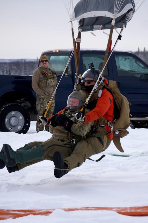 212th Rescue Squadron marks change of command with unique Alaska backdrop
