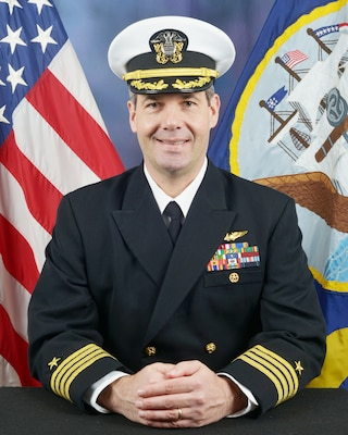 Official biography photo of Captain Langenberg