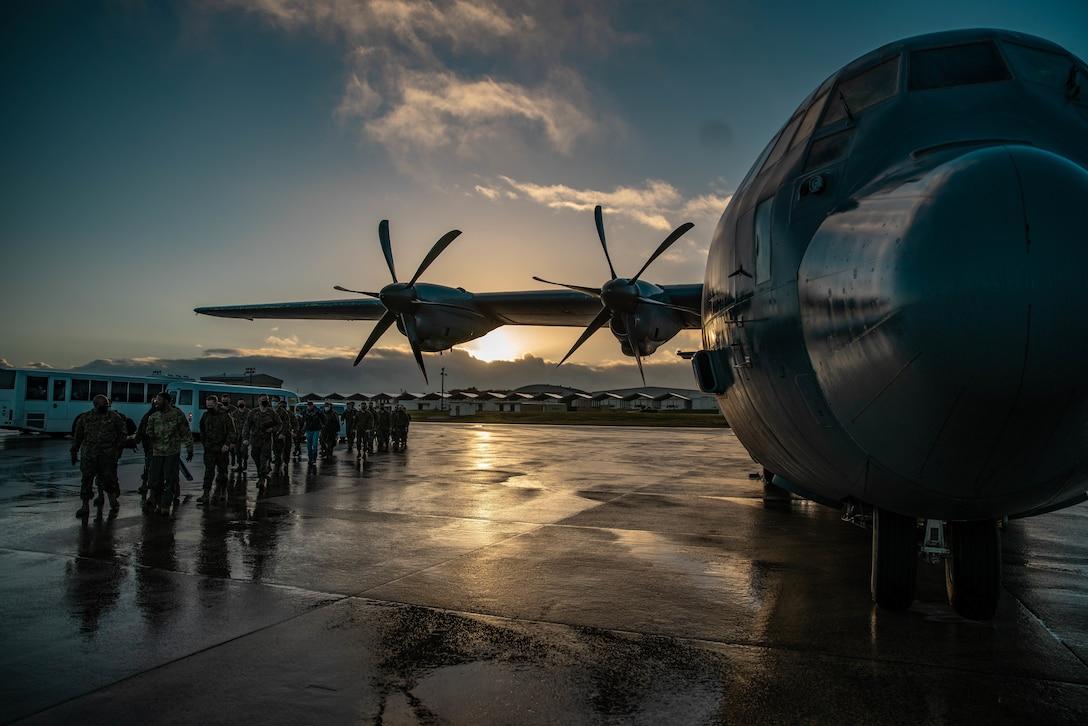 U.S. Marines board a C-130 departing for a Maritime Prepositioning Force operation in support of Hagåtña Fury 21 at Kadena Air Base, Okinawa, Japan, Feb. 13.