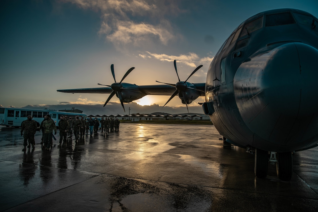 U.S. Marines board a C-130 departing for a Maritime Prepositioning Force operation in support of Hagåtña Fury 21 at Kadena Air Base, Okinawa, Japan, Feb. 13.