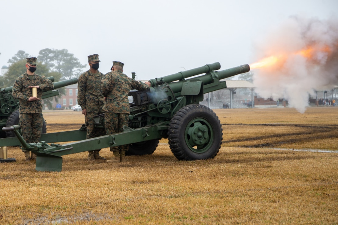 U.S. Marines with Fox Battery, 2nd Battalion, 10th Marine Regiment, 2d Marine Division, fire 155mm blank rounds for a 21-gun salute during a Presidents Day ceremony on Camp Lejeune, N.C., Feb. 15, 2021. Presidents Day originally celebrated U.S. Presidents George Washington and Abraham Lincoln's birthdays, it now honors past president's lives and birthdays. (U.S. Marine Corps photo by Pfc. Sarah Hediger)