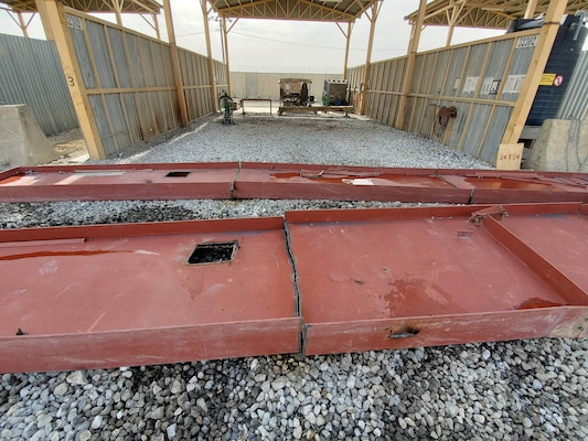 Huge pieces of building materials are reduced to more manageable sizes at a cutting bay at the DLA Disposition Services site at Bagram, Afghanistan.
