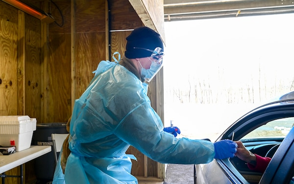U.S. Army Spc Braxton Price, assigned to the 1729th Support Maintenance Company, Maryland National Guard, works with the Allegany County Health Department to assist residents with COVID-19 testing on Feb. 3, 2021, in Cumberland, Maryland.