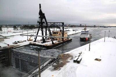 A crane ship lifts bars.
