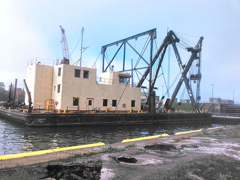 A crane barge floats.
