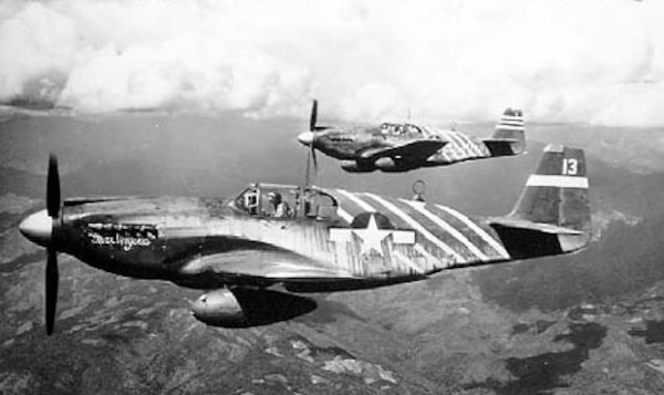 U.S. Army Col. Phillip Cochran, the commander of the 1st Air Commando Group, flies an aircraft over Burma during World War II.