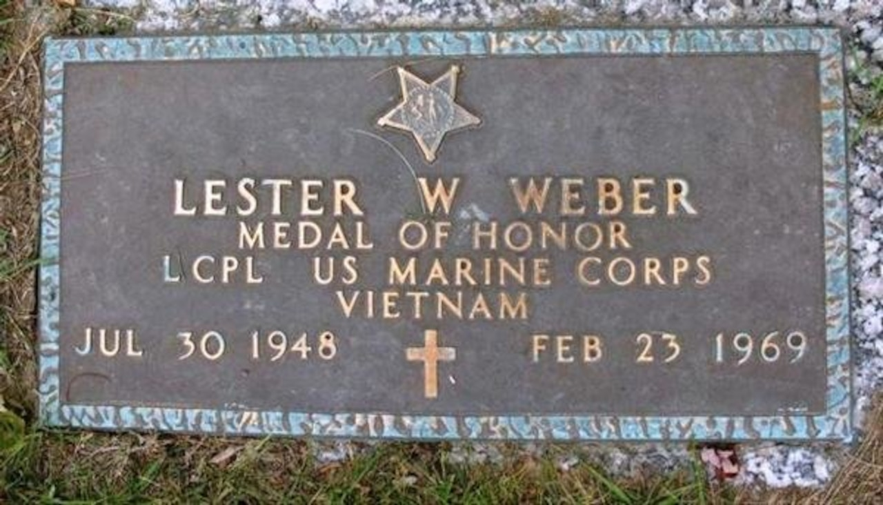 A grave marker provides information about a man named Lester W. Weber.