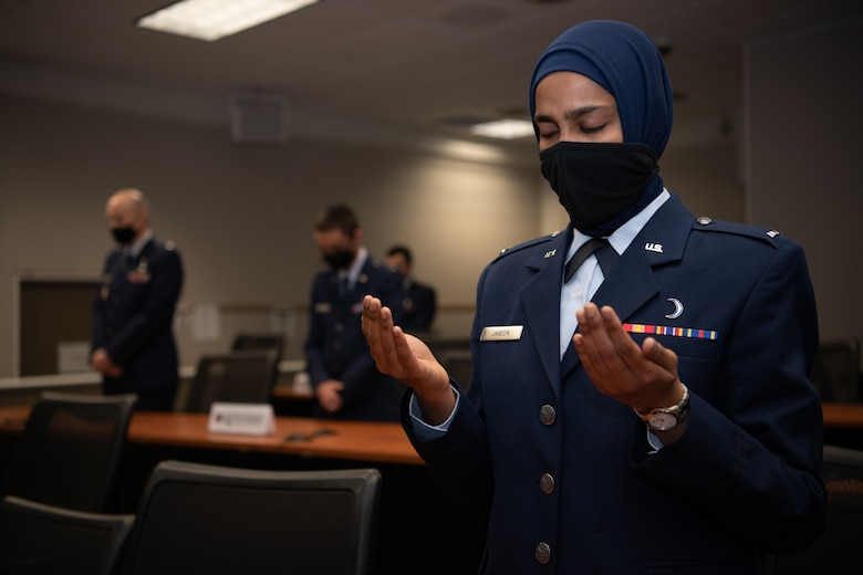 First Lt. Saleha Jabeen, a graduate of Basic Chaplain Course Class 21A, raises her hands in prayer during a group prayer at the start of the graduation ceremony Feb. 5, 2021, at the Ira C. Eaker Center for Leadership Development on Maxwell Air Force Base, Ala. Jabeen, a native of India, is the first female Muslim chaplain to serve in the U.S. military.