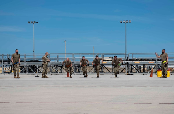 Airmen from the Air Mobility Operations Wing sprint through the physical relay part of the Port Dawg Rodeo events at Andersen Air Force Base, Guam, Feb. 11, 2021.