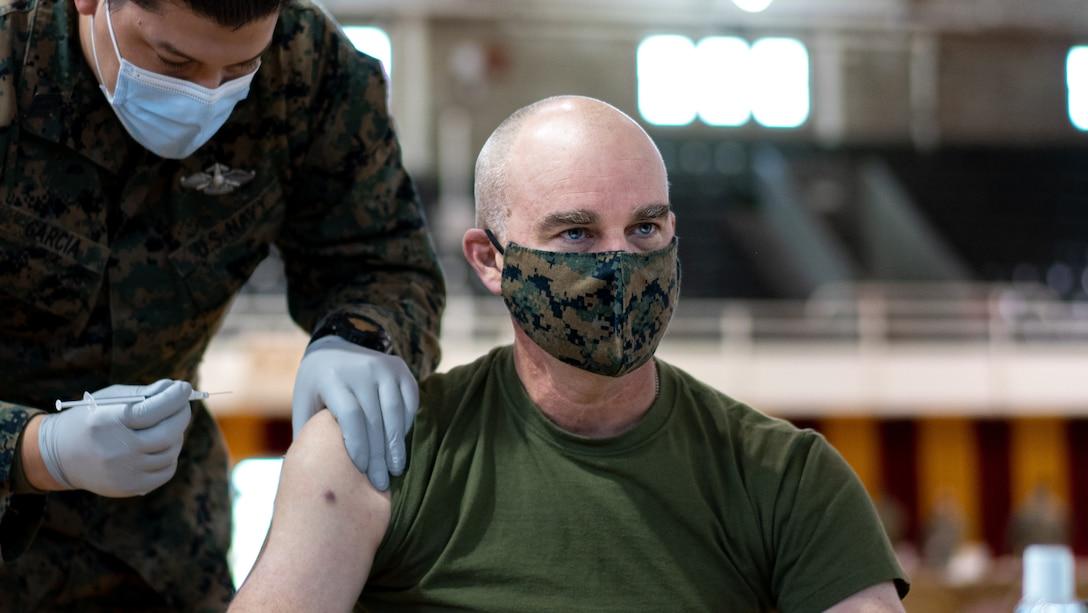 A U.S. Marine receives the the Pfizer-BioNTech COVID-19 vaccine at Goettge Memoria Field House on Camp Lejeune, N.C., Jan. 28.