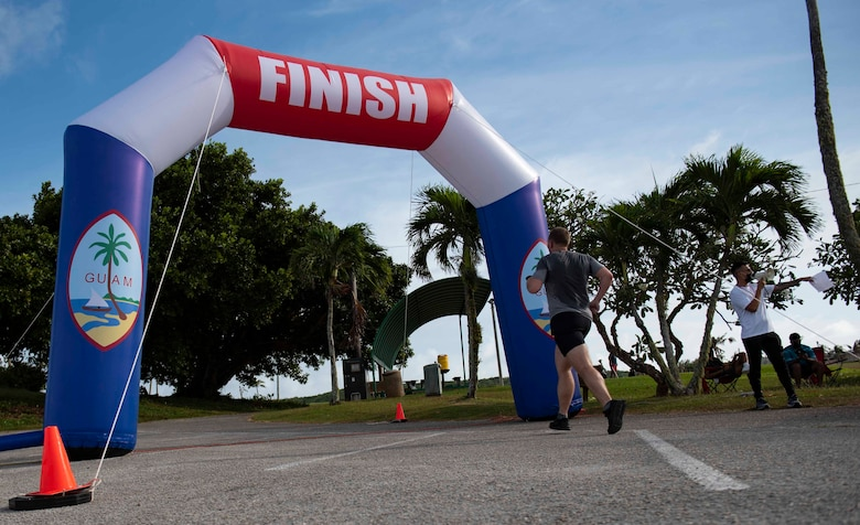 A participant finishes the first ever Fat Tuesday 5K fun run at Andersen Air Force Base, Guam, Feb. 16, 2021.