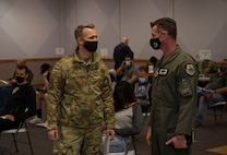 two Airmen face each other in waiting room