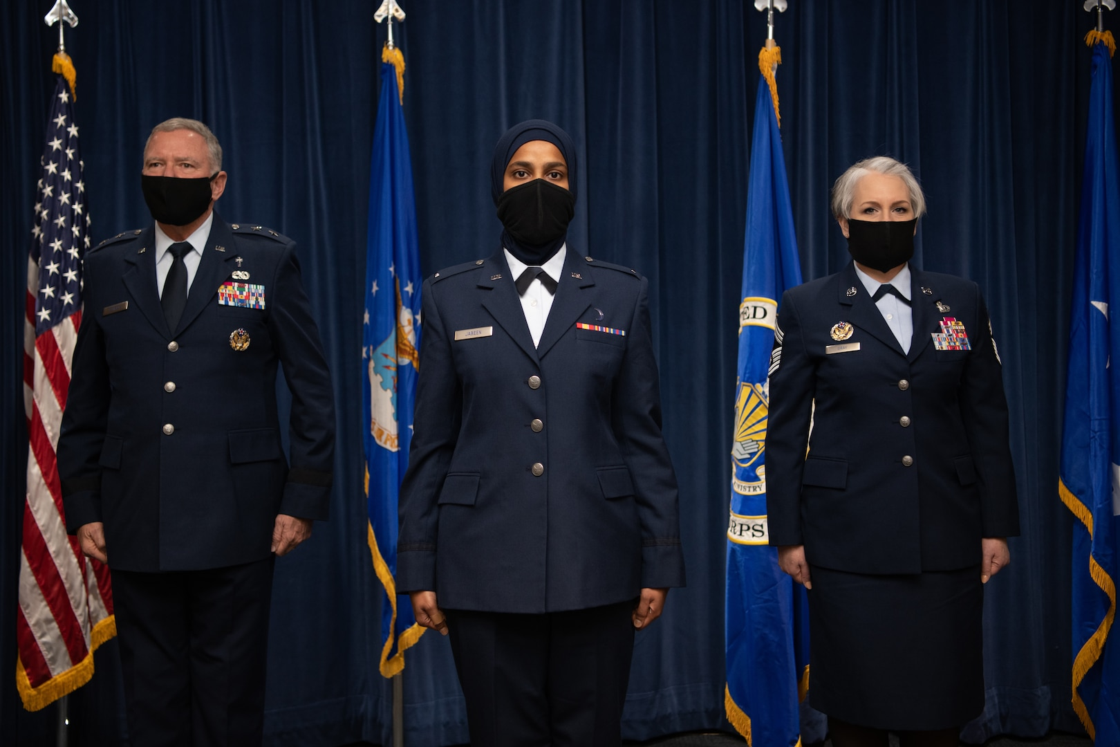Maj. Gen. Steven Schaik, Air Force chief of chaplains, 1st Lt. Saleha Jabeen, a graduate of Basic Chaplain Course Class 21A, and Chief Master Sgt. Natalie Gray, Air Force Chaplain Corps senior enlisted advisor and religious affairs career field manager, pose for a photo during the graduation ceremony Feb. 5, 2021, at the Ira C. Eaker Center for Leadership Development on Maxwell Air Force Base, Ala. Schaik and Gray congratulated each graduate of the Basic Chaplain Course onstage as they received their chaplain coin.