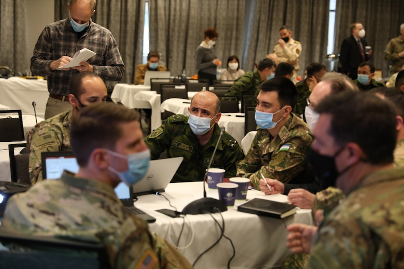 Soldiers from the United States, Uzbekistan, and Tajikistan work together to plan the multilateral exercise REGIONAL COOPERATION 21 in Helena, Montana, Feb. 3, 2021. Twelve representatives from Central Asian countries visited Montana for this initial planning conference.