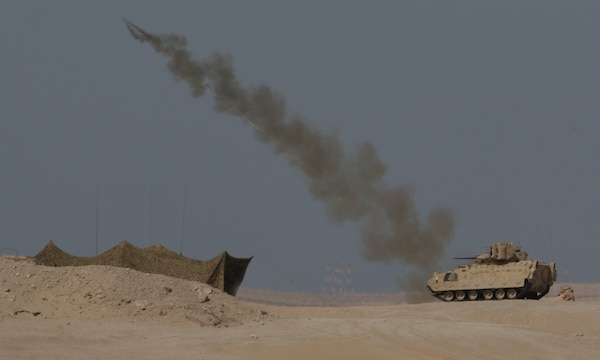 A U.S. Army M1150 Assault Breacher Vehicle from 1st Battalion, 6th Infantry Regiment, 2nd Brigade Combat Team, 1st Armored Division, launches its Linear Demolition Charge System during a live-fire exercise portion of Iron Union 14 at Al Hamra Training Center in the United Arab Emirates, Feb. 4, 2021. Iron Union is a recurring, bilateral exercise that is designed for U.S. forces to train with UAE counterparts in addressing common threats to regional security in Southwest Asia. (U.S. Army photo by Staff Sgt. Daryl Bradford, Task Force Spartan Public Affairs)