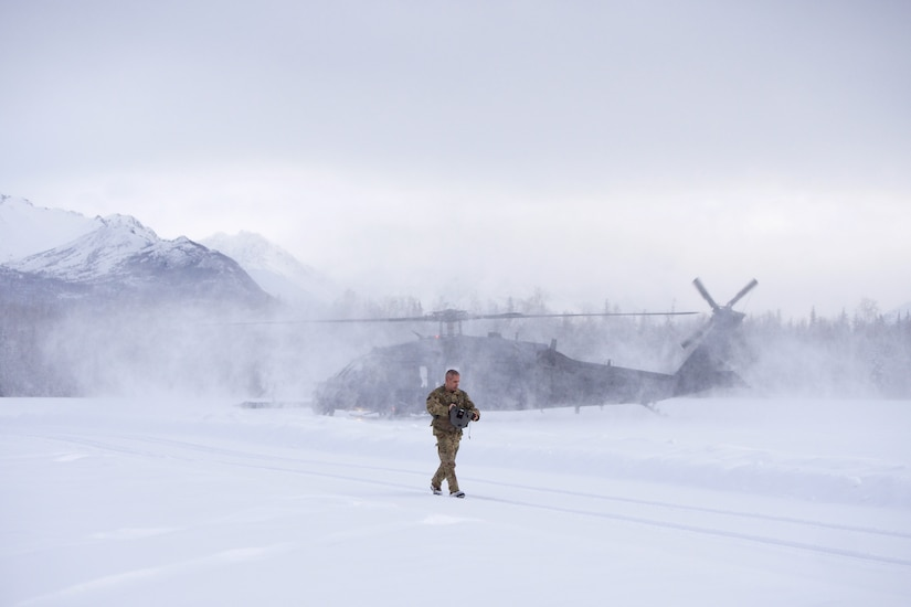 212th Rescue Squadron marks change of command with unique Alaska backdrop