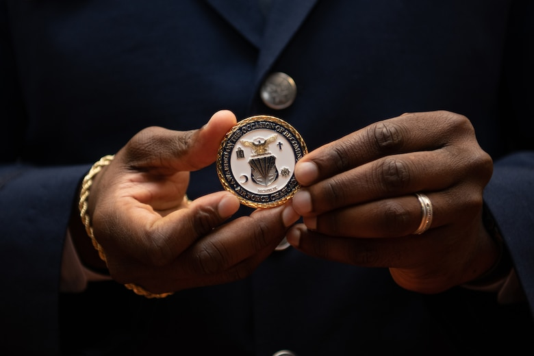 1st Lt. Fred Gallop III, a graduate of Basic Chaplain Course Class 21A, holds his Air Force chaplain coin up for a photo Feb. 5, 2021, at the Ira C. Eaker Center for Leadership Development on Maxwell Air Force Base, Ala. Each graduate was presented with a numbered coin during the graduation ceremony.