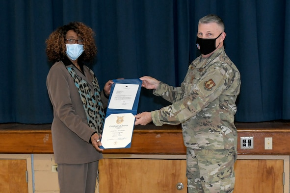 Photo shows woman getting certificate from man.