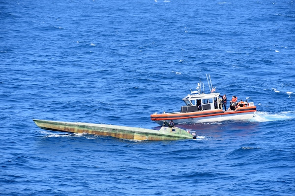 Coast Guard Cutter Bertholf (WMSL 750) boarding teams interdict a low-profile vessel in the Eastern Pacific Ocean, seizing more than 4,380 pounds of cocaine, Feb. 1, 2021.