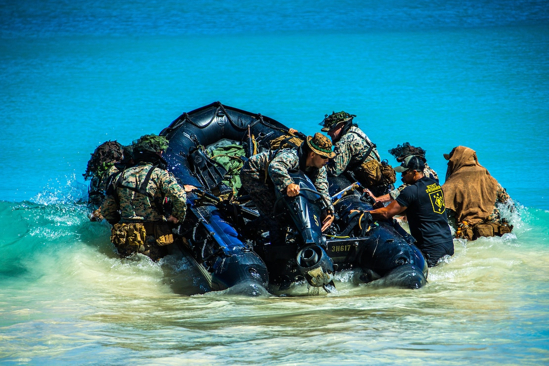 U.S. Marines embark a combat rubber raiding craft during reconnaissance scout swimmer training during Exercise Bougainville I at Marine Corps Training Area Bellows, Hawaii, Feb. 8.