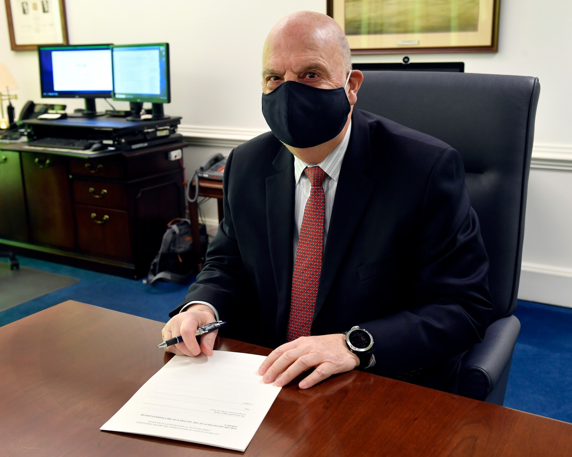 Acting Secretary of the Air Force John P. Roth prepares to sign a letter of intent for continued U.S. support of the Arctic Challenge exercise, one of Europe's largest tactical air exercises.
