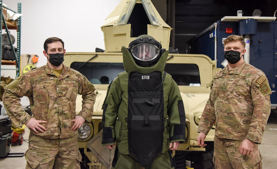 U.S. Air Force Senior Airman Charles Kirwan (left), Airman 1st Class Travis Callahan (middle) and Airman 1st Class Kyle Riley, 92nd Civil Engineer Squadron Explosive Ordnance Disposal technicians, pose for a photo at Fairchild Air Force Base, Washington, Feb. 16, 2021. Fairchild's EOD emergency response spans an 85-thousand square mile radius supporting federal and local law enforcement agencies throughout Washington, Northern Idaho and select counties in Montana and Oregon. (U.S. Air Force photo by Airman 1st Class Anneliese Kaiser)
