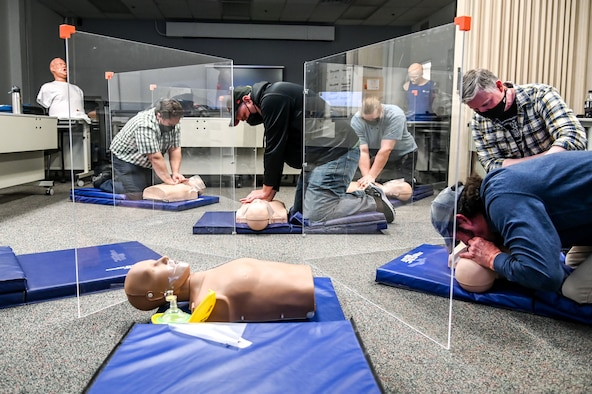 Students practice compressions and rescue breaths in the cardiopulmonary resuscitation, or CPR, class Feb. 8, 2021, at Hill Air Force Base, Utah. The CPR class is one of the several classes still being offered during the pandemic with modifications from 75th Force Support Squadron's Education and Training Center. (U.S. Air Force photo by Cynthia Griggs)