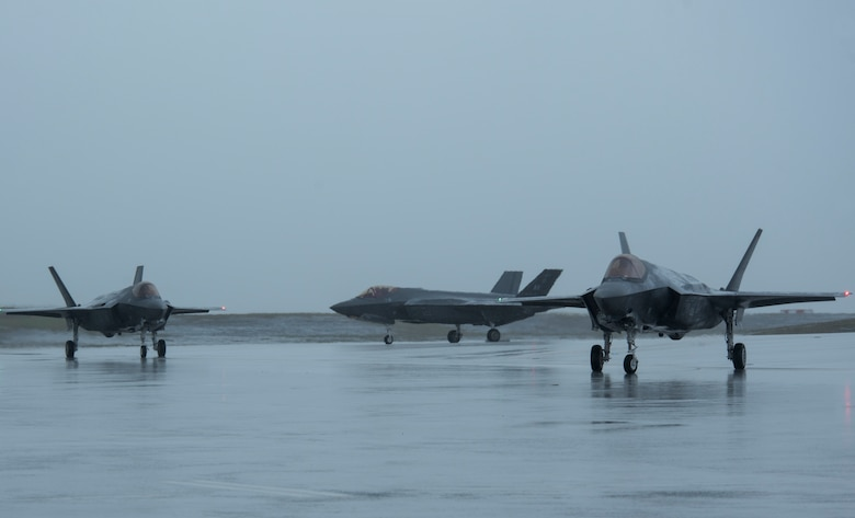 Three U.S. Air Force F-35A Lightning II assigned to Eielson Air Force Base, Alaska, taxi on the flightline as part of Cope North 21 at Andersen AFB, Guam, Feb. 6, 2021. The mission of the exercise is to focus on coordination of combined air tactics, techniques and procedures, and enhancing security and stability in the Indo-Pacific region. (U.S. Air Force photo by Senior Airman Jonathan Valdes Montijo)