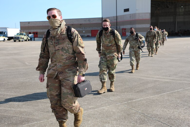 Hundreds of Airmen depart for the Gulfport Combat Readiness Training Center in Gulfport, Miss., Nov. 6, 2020 after completing a restriction of movement at Camp Gulfport to become eligible for deployment.