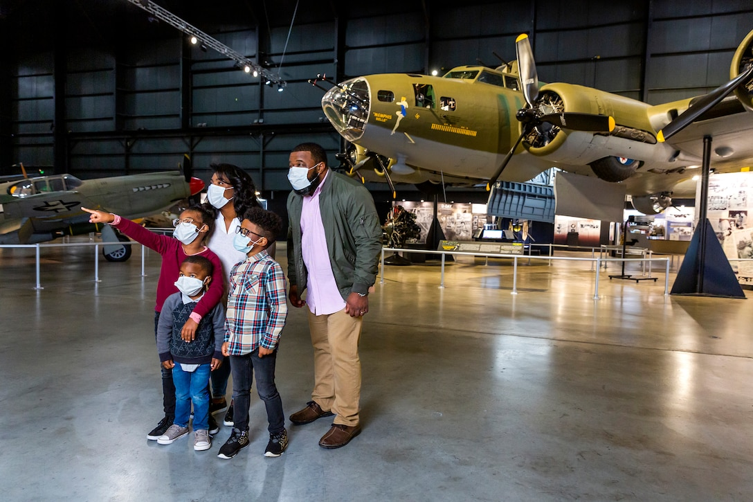Family in front of the B-17 Memphis Belle in the World War II Gallery.