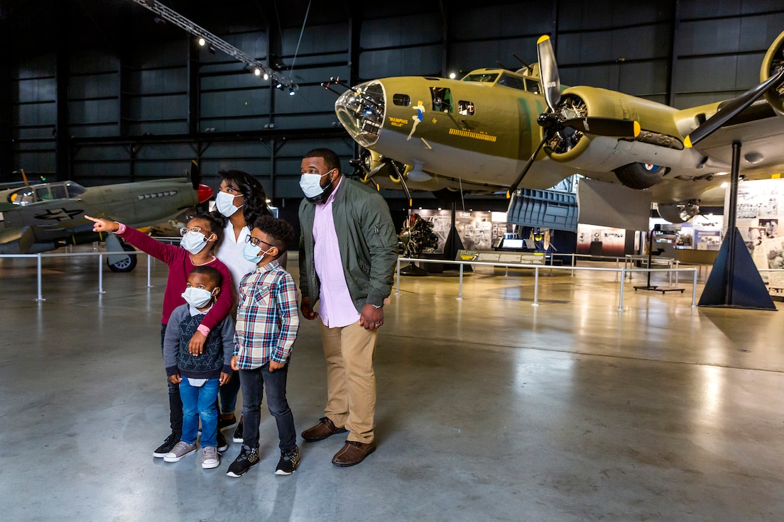 Family in front of the B-17 Memphis Belle in the World War II Gallery. (Photo by Matthew Allen)