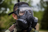 A U.S. Marine assigned to Chemical Biological Radiological and Nuclear (CBRN) Defense School, wears his M50 joint service general-purpose mask during a field training exercise at Fort Leonard Wood, Mo., May 11, 2016. CBRN training teaches Marines how to utilize their issued gear enabling them to survive in a chemical environment.