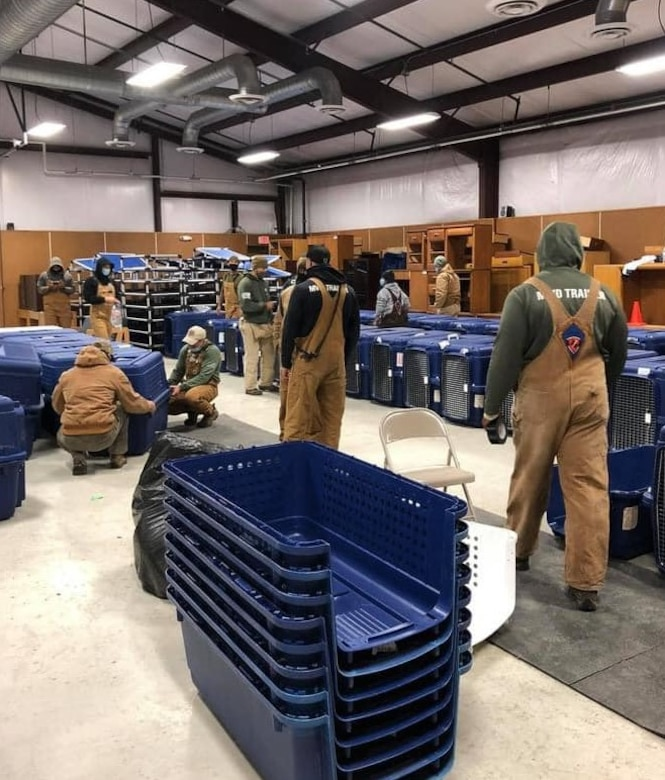 Teams put together crates, moved food, set up walking tracks and provided food and drinks in order to get four-legged warriors indoors in anticipation of this week's cold conditions at Joint Base San Antonio, Texas.