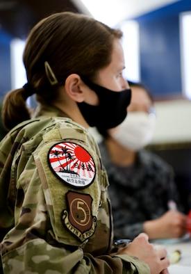 U.S. Air Force Maj. Brittany Morreale serves as an interpreter for a Japan Air Self-Defense Force, or Koku-Jieitai, and a Royal Australian Air Force member during Cope North 21