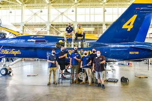 U.S. Air Force Airmen from the 735th Air Mobility Squadron reassemble a U.S. Navy Blue Angel F/A-18 on Joint Base Pearl Harbor-Hickam, Hawaii, Feb. 9, 2021. The Pearl Harbor Aviation Museum's mission is to steward America's first aviation battlefield of World War II – sharing the artifacts, personal stories, the impact and response to the attack on December 7, 1941, and the Pacific region battles that followed.  (U.S. Air Force photo by Tech. Sgt. Anthony Nelson Jr.)