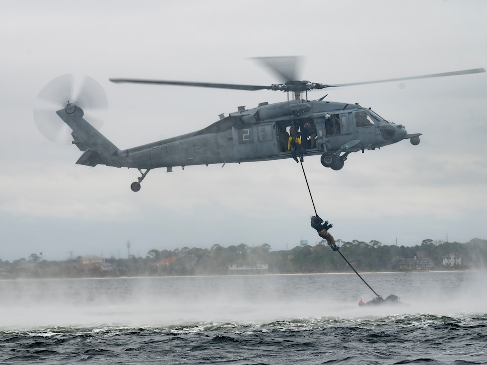 U.S. Air Force Special Tactics operators assigned to the 24th Special Operations Wing, conduct hoist operations with U.S. Navy MH-60 Seahawk aircrew members assigned to Helicopter Sea Combat Squadron Nine, during Emerald Warrior 21.1, at Hurlburt Field, Fla., Feb. 18, 2021.