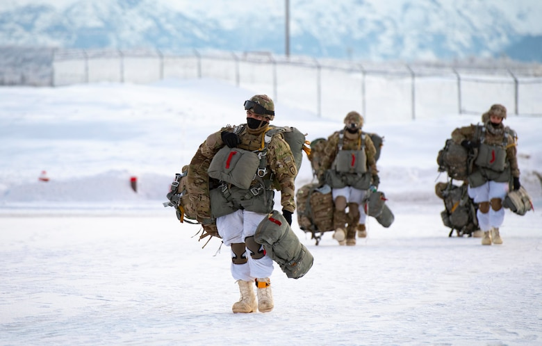 U.S. Army paratroopers, assigned to the 4th Infantry Brigade Combat Team (Airborne), 25th Infantry Division (Spartan Brigade), approach a C-130J Super Hercules, assigned to the 36th Airlift Squadron, Yokota Air Base, Japan, during exercise Arctic Warrior 21 at Joint Base Elmendorf-Richardson, AK, Feb. 8, 2021