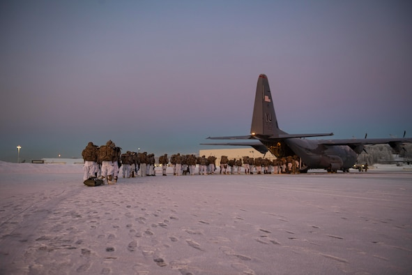 U.S. Army paratroopers, assigned to the 4th Infantry Brigade Combat Team (Airborne), 25th Infantry Division (Spartan Brigade), board a C-130J Super Hercules, assigned to the 36th Airlift Squadron, Yokota Air Base, Japan, during exercise Arctic Warrior 21 at Joint Base Elmendorf-Richardson, AK, Feb. 8, 2021