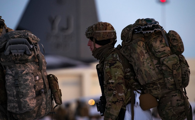 U.S. Army paratroopers, assigned to the 4th Infantry Brigade Combat Team (Airborne), 25th Infantry Division (Spartan Brigade), prepare to board a C-130J Super Hercules, assigned to the 36th Airlift Squadron, Yokota Air Base, Japan, during exercise Arctic Warrior 21 at Joint Base Elmendorf-Richardson, AK, Feb. 8, 2021.