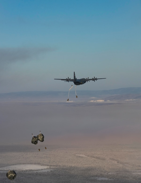 U.S. Army paratroopers, assigned to 3rd Battalion, 509th parachute infantry regiment, 4th Infantry Brigade Combat Team (Airborne), 25th Infantry Division jump out of a C-130J Super Hercules, assigned to the 36th Airlift Squadron, Yokota Air Base, Japan, as part of exercise Arctic Warrior 21 at Donnelly Training Area, AK, Feb. 8, 2021.