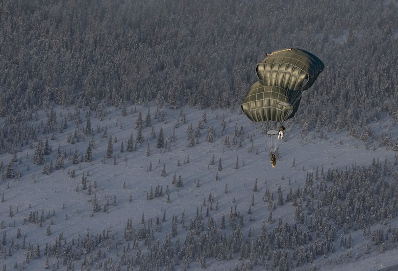 U.S. Army paratroopers, assigned to 4th Infantry Brigade Combat Team (Airborne), 25th Infantry Division (Spartan Brigade), jump out of a C-130J Super Hercules, assigned to the 36th Airlift Squadron, Yokota Air Base, Japan, as part of exercise Arctic Warrior 21 at Donnelly Training Area, AK, Feb. 8, 2021.