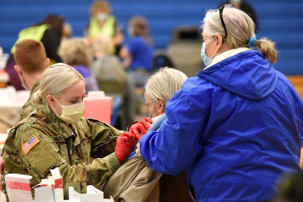 A Michigan Army National Guard Soldier administers a COVID-19 vaccine in Centerville, Michigan, Feb. 17, 2021. The Michigan Department of Health and Human Services and Michigan National Guard have been working throughout the pandemic to increase access to vaccinations across the state.