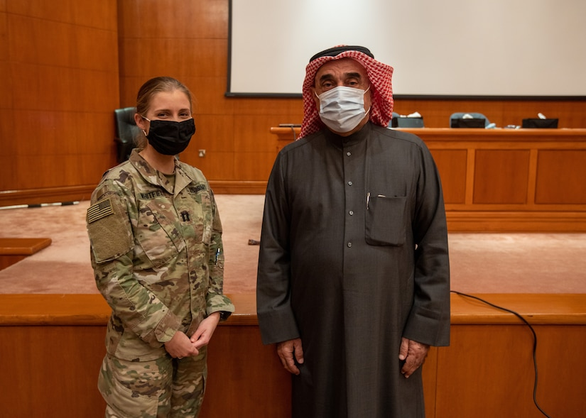 Cpt. Emrick Whitfield, veterinary clinic officer in charge, Area Support Group Kuwait, poses with the General Director for the Public Authority of Agriculture Affairs and Fish Resources, Mohamed Alsabah, after a canine behavior and safety seminar in Rabia, Kuwait, Feb. 2, 2021. The seminar was hosted by the Kuwaiti Public Authority of Agriculture Affairs and Fish Resources and conducted by Whitfield.