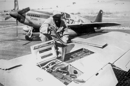 Editor's note: photo and caption were pulled from the National Archives Catalog. An armorer of the 15th U.S. Air Force checks ammunition belts of the .50 caliber machine guns in the wings of a P-51 Mustang fighter plane before leaving an Italian base for a mission against German military targets. The 15th Air Force was organized for long-range assault missions, and its fighters and bombers range over enemy targets in occupied and satellite nations, as well as Germany itself.  Ca. September 1944. 208-MO-18H-32984.