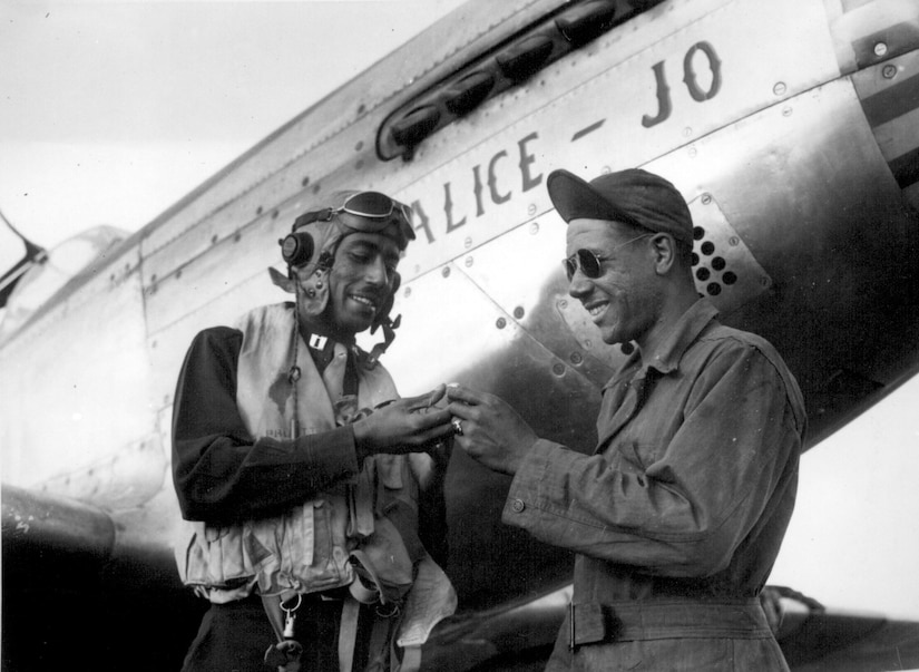 Editor's note: photo and caption were pulled from the National Archives Catalog. Capt. Wendell O. Pruitt., one of the leading pilots of the 15th Air Force, always makes sure that he leaves his valuable ring with his crew chief, S/Sgt. Samuel W. Jacobs.                                               Ca. November 1944. 208-AA-46BB-4.